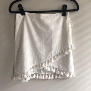 White mini skirt with tassels